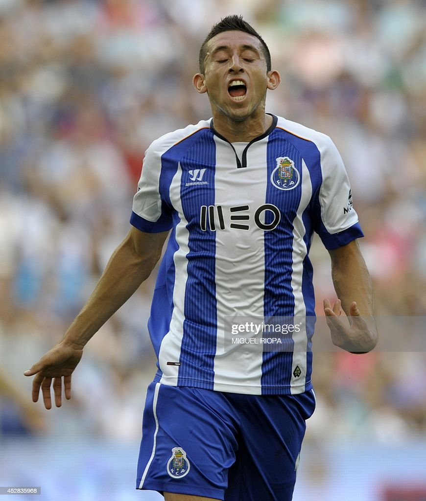 Porto s Mexican midfielder Hector Herrera reacts during the