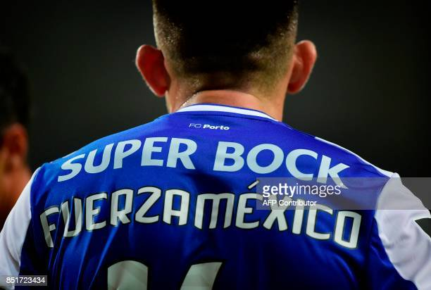 Porto's Mexican midfielder Hector Herrera sports a jersey reading 'Push on Mexico' during the Portuguese league football match FC Porto vs...