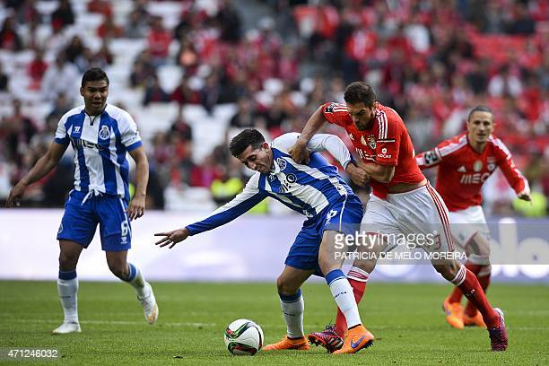 Porto's Mexican midfielder Hector Herrera vies with Benfica's Brazilian defender Jardel Vieira during the Portuguese league football match SL Benfica...