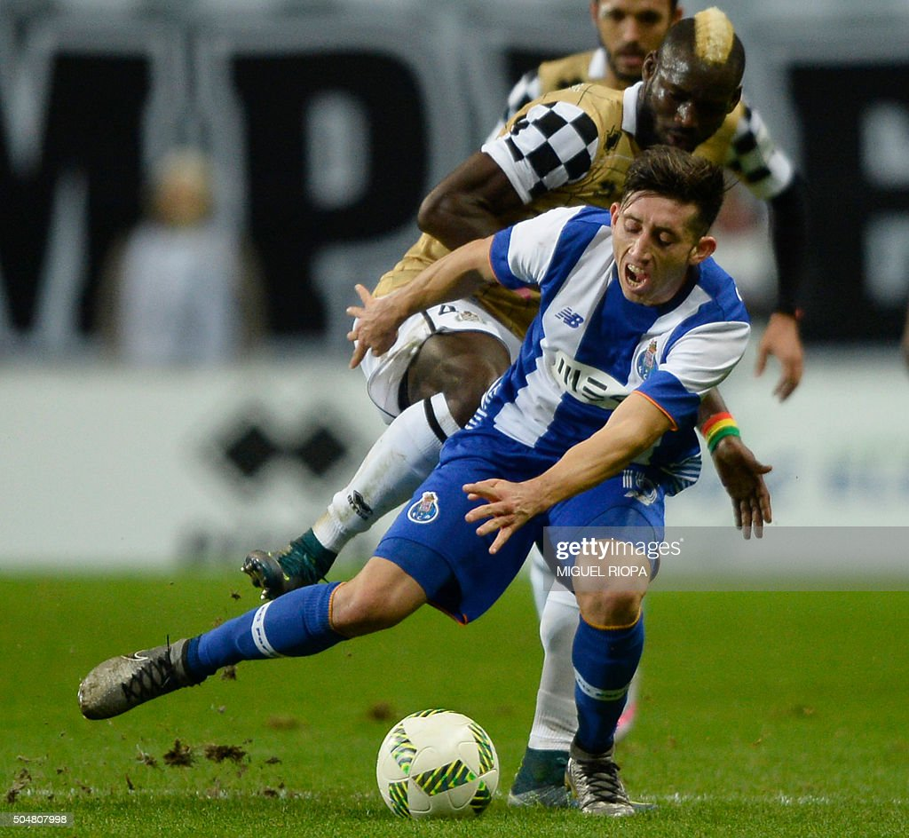 Porto s Mexican midfielder Hector Herrera bottom vies with
