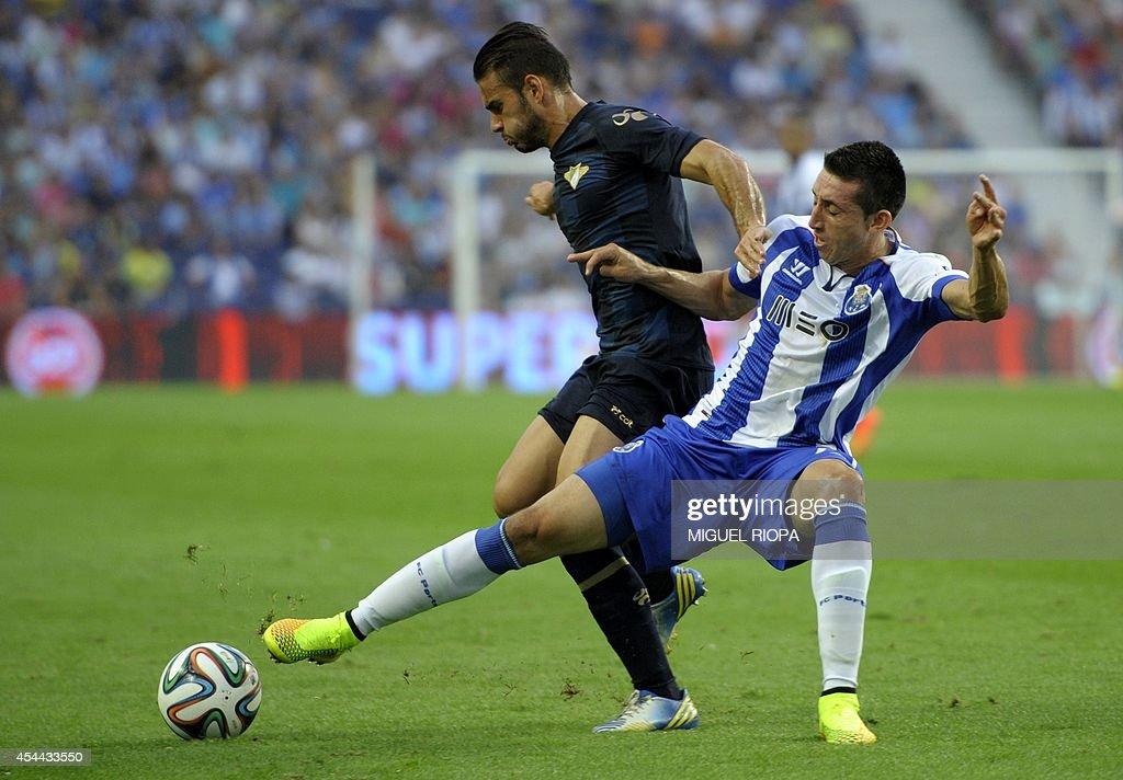 Porto's Mexican midfielder Hector Herrera (R) vies with Moreirense's midfielder Jorge Monteiro during the Portuguese league football match FC Porto vs Moreirense at the Dragao Stadium in Porto, on August 31, 2014. Porto won the match 3-0.