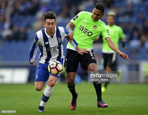 Porto's Mexican midfielder Hector Herrera vies with Rio Ave's Brazilian midfielder Filipe Augusto during the Portuguese league football match FC...