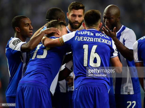 Porto's Mexican midfielder Hector Herrera wears a jersey reading 'Push on Mexico' as he celebrates with teammates a goal during the Portuguese league...