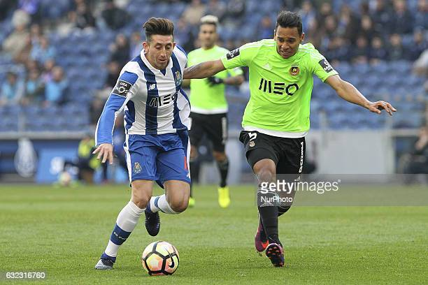 Porto's Mexican midfielder Hector Herrera with Rio Ave's Brazilian midfielder Filipe Augusto during the Premier League 2016/17 match between FC Porto...