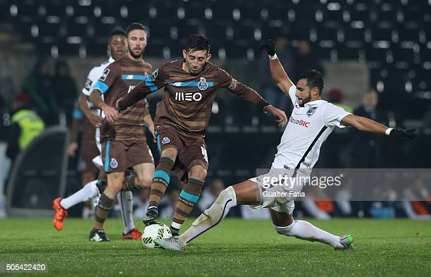 Porto's mexican midfielder Hector Herrera with Vitoria de Guimaraes's forward Henrique Dourado in action during the Primeira Liga match between...