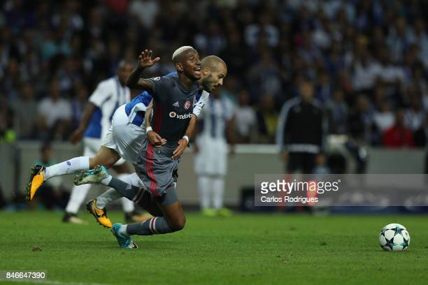 Porto's midfielder Andre Andre from Portugal tackles Besiktas midfielder Andersson Talisca from Brasil during the match between FC Porto v Besiktas...