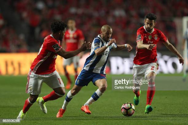 Porto's midfielder Andre Andre from Portugal tries to escape Benfica's defender Eliseu from Portugal and Benfica's forward Pizzi from Portugal during...