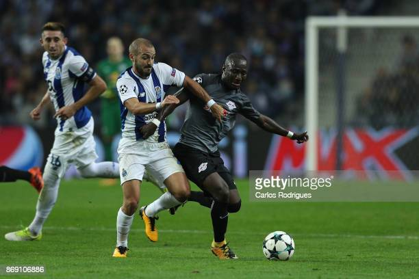 Porto's midfielder Andre Andre from Portugal vies with Leipzig midfielder Naby Keita from Guine for the ball possession during the match between FC...