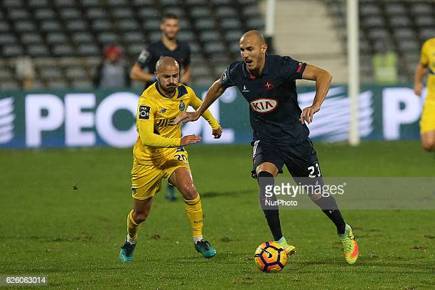 FC Portos midfielder Andre Andre from Portugal with Belenensess midfielder Hassan Yebda from Algeria during Premier League 2016/17 match between Os...