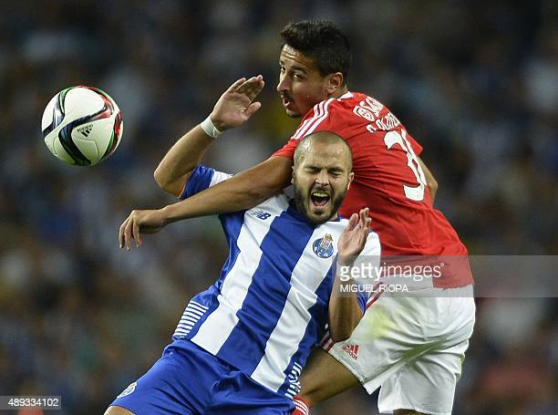 Porto's midfielder Andre Andre jumps for the ball with Benfica's defender Andre Almeida during the Portuguese league football match FC Porto vs SL...