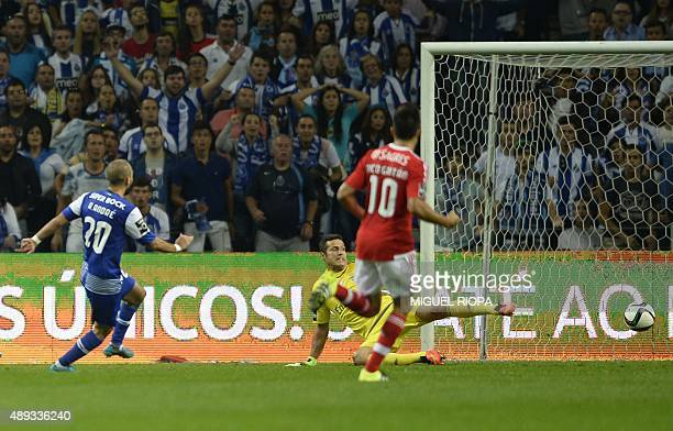 Porto's midfielder Andre Andre kicks the ball to score a goal during the Portuguese league football match FC Porto vs SL Benfica at the Dragao...