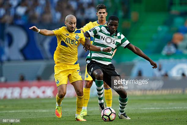 Porto's midfielder Andre Andre vies for the ball with Sporting's midfielder William Carvalho during Premier League 2016/17 match between Sporting CP...