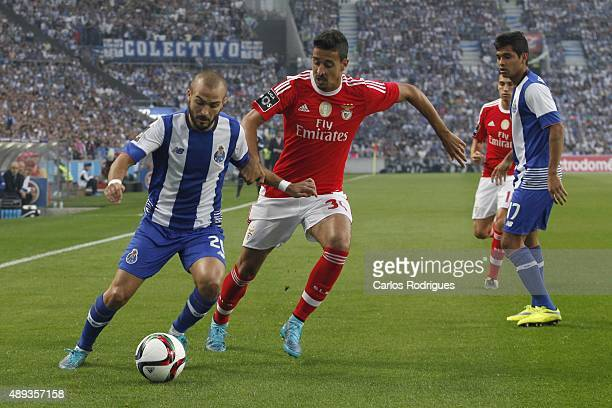 Porto's midfielder Andre Andre vies with Benfica's midfielder Andre Almeida during the match between FC Porto and SL Benfica for the Portuguese...
