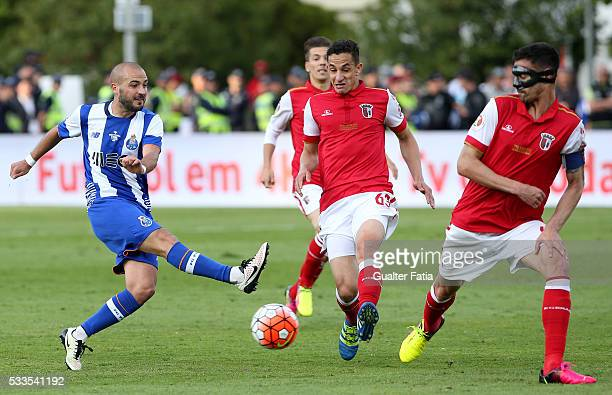 Porto's midfielder Andre Andre with SC Braga's midfielder Mauro and SC Braga's defender Andre Pinto in action during the Portuguese Cup Final match...