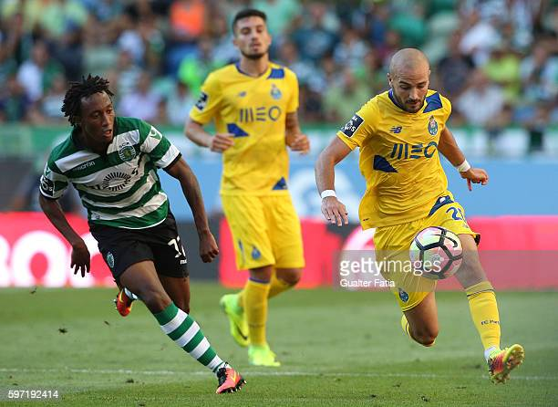 Porto's midfielder Andre Andre with Sporting CP's forward Gelson Martins in action during the Primeira Liga match between Sporting CP and FC Porto at...