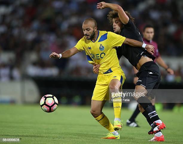 Porto's midfielder Andre Andre with Vitoria Guimaraes' midfielder Joao Pedro in action during the Guimaraes City Trophy match between Vitoria de...