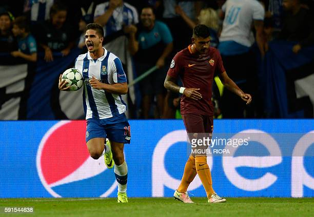 Porto's midfielder Andre Silva celebrates next to AS Roma's Brazilian defender Emerson Palmieri after scoring a penalty during the UEFA Champions...