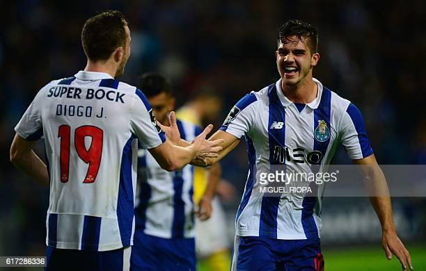 Porto's midfielder Andre Silva celebrates with teammate forward Diogo Jota after scoring a goal during the Portuguese league football match FC Porto...