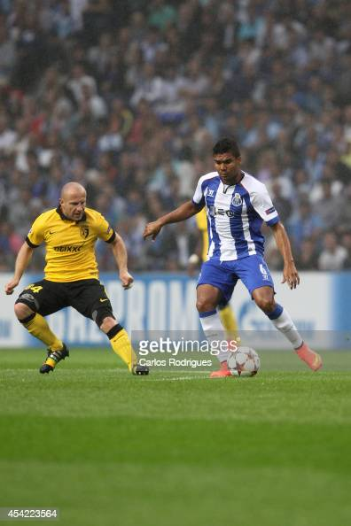 Porto's midfielder Casemiro tries to escape Lille's midfielder Florent Balmont during the football match between FC Porto and LOSC Lille at Dragao...