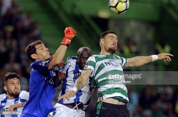 Porto's midfielder Danilo Pereira and Porto's Spanish goalkeeper Iker Casillas block a header by Sporting's Uruguayan Sebastian Coates during the...