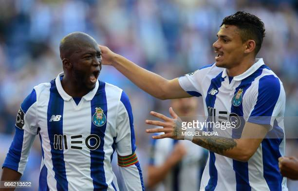 Porto's midfielder Danilo Pereira celebrates with teammate Brazilian forward Soares after scoring a goal during the Portuguese league football match...