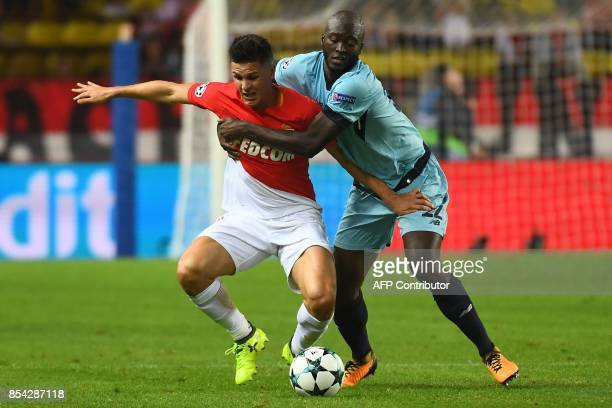 Porto's midfielder Danilo Pereira holds Monaco's Argentinian forward Guido Carrillo during the UEFA Champions League Group G football match AS Monaco...