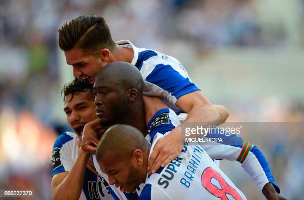 Porto's midfielder Danilo Pereira is congratulated by teammates Algerian forward Yacine Brahimi Brazilian forward Soares and forward Andre Silva...