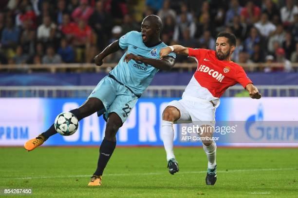 Porto's midfielder Danilo Pereira shoots on goal before Monaco's Portuguese midfielder Joao Moutinho prior to Porto's first goal during the UEFA...