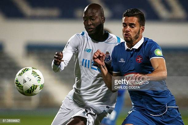 Porto's midfielder Danilo Pereira vies with Belenenses's forward Fabio Nunes during the Portuguese league football match OS Belenenses vs FC Porto at...