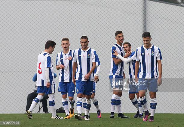 Porto's midfielder Joao Cardoso celebrates with teammates after scoring a goal during the UEFA Youth Champions League match between FC Porto and...