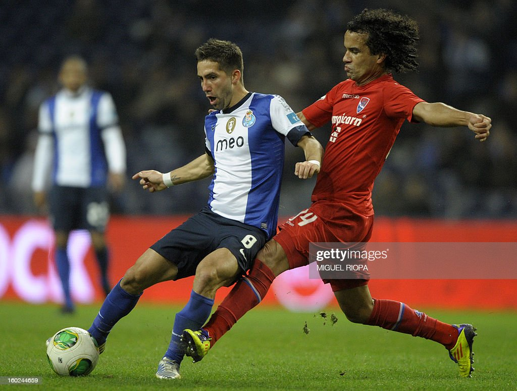 Porto's midfielder Joao Moutinho (L) vies with Gil Vicente's Brazilian defender Claudio during the Portuguese league football match FC Porto vs Gil Vicente at the Dragao Stadium in Porto on January 28, 2013.