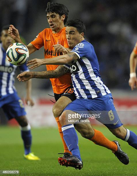 Porto's midfielder Josue Pesqueira vies with Belenenses' midfielder Bruno China during the Portuguese league football match FC Porto v CF Os...