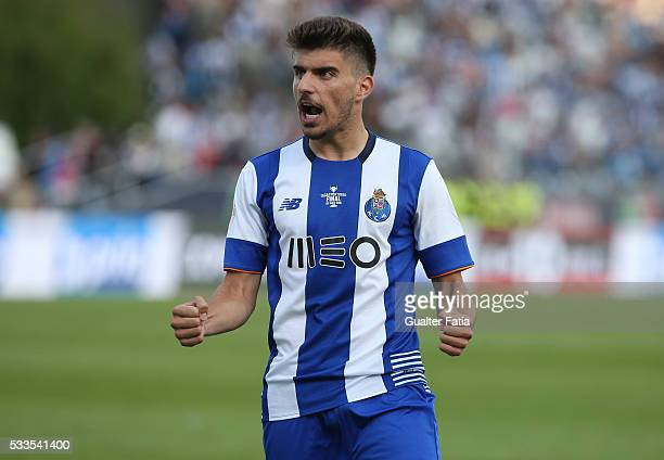 Porto's midfielder Ruben Neves celebrates after scoring a penalty in the penalty shootout during the Portuguese Cup Final match between FC Porto and...