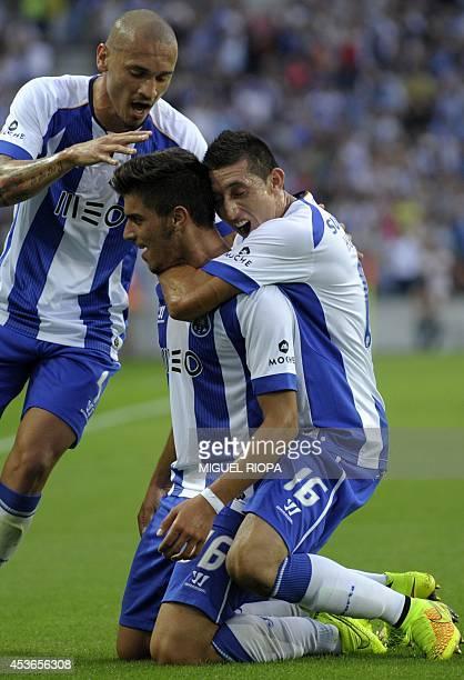 Porto's midfielder Ruben Neves celebrates with his teammates Porto's Brazilian defender Maicon and Mexican midfielder Hector Herrera after scoring...