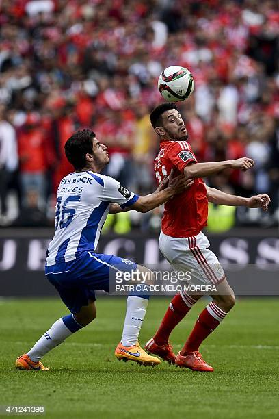 FC Porto's midfielder Ruben Neves vies with Benfica's forward Luis Fernandes 'Pizzi' during the Portuguese league football match SL Benfica vs FC...