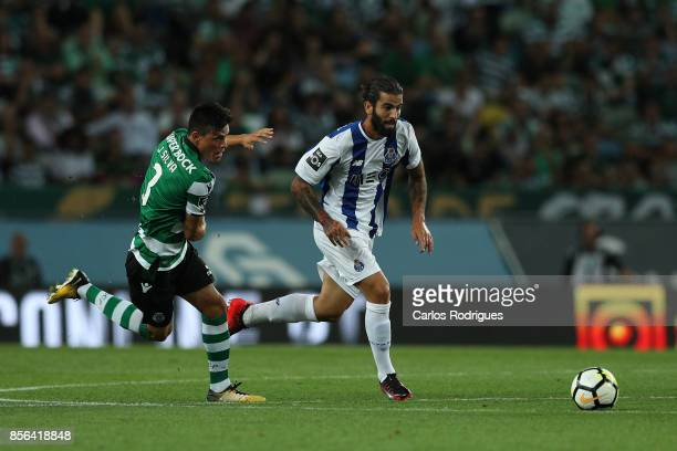 Porto's midfielder Sergio Oliveira from Portugal tries to escape Jonathan Silva during the Portuguese Primeira Liga round two match between Sporting...