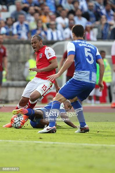 Porto's midfielder Yacine Brahimi tackles Braga's defender Baiano during the match between FC Porto and SC Braga for the Portuguese Cup Final at...