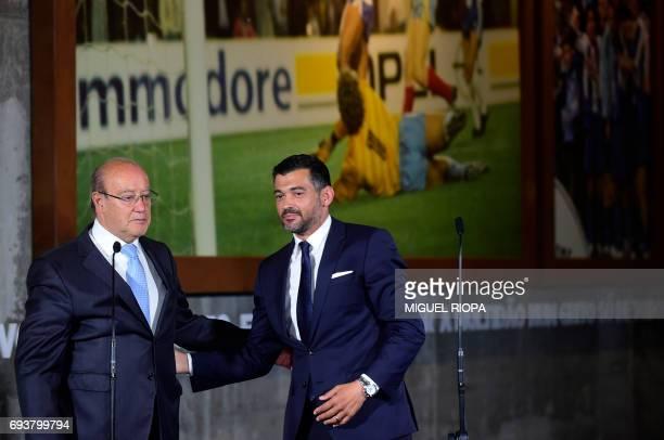 FC Porto's new coach Sergio Conceicao is congratulated by Porto's President Jorge Nuno Pinto da Costa during his official presentation at the Dragao...