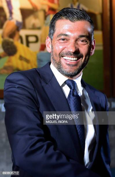 FC Porto's new coach Sergio Conceicao smiles during his official presentation at the Dragao stadium in Porto on June 8 after signing his new contract...