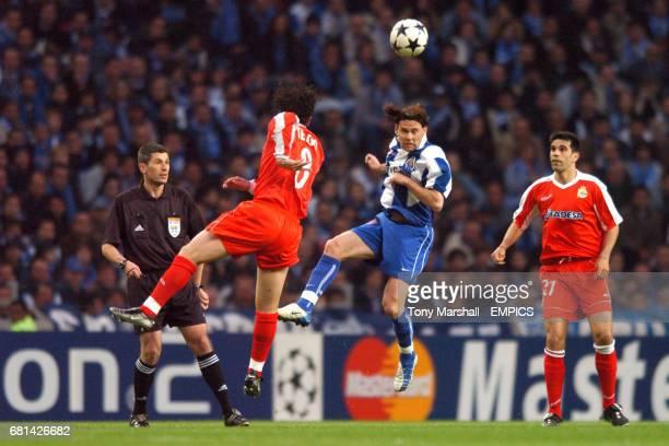 FC Porto's Nuno Valente heads clear under pressure from Deportivo La Coruna's Juan Valeron
