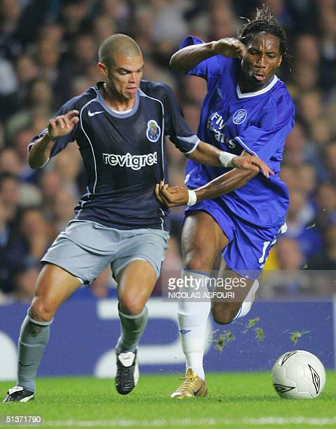 Porto's Pepe fights for the ball with Chelsea's Didier Drogba during their Champions League football match 29 September 2004 at Stamford Bridge in...