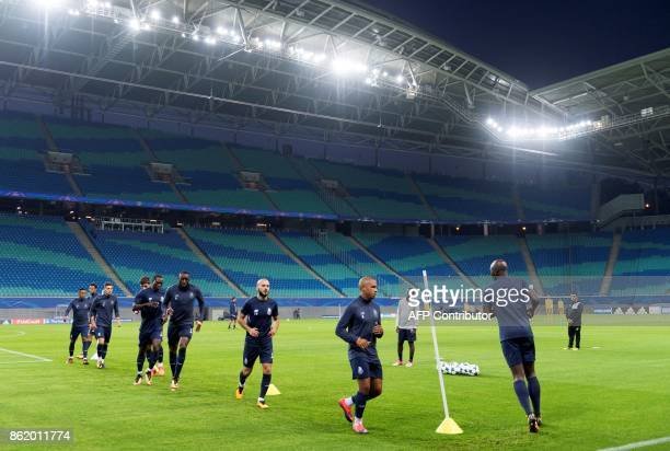 Porto's players attend a training session on the eve of the UEFA Champions League football match between RB Leipzig and FC Porto in Leipzig eastern...
