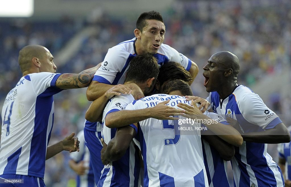 Porto's players celebrate after scoring during the Portuguese league football match FC Porto vs Moreirense at the Dragao Stadium in Porto, on August 31, 2014. Porto won the match 3-0.