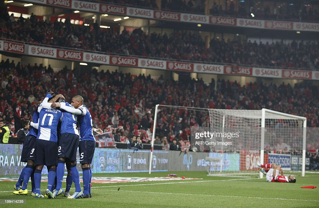 FC Porto's players celebrate after teammate Jackson Martinez scored during the Portuguese league football match SL Benfica vs FC Porto at Luz Stadium in Lisbon on January 13, 2013.