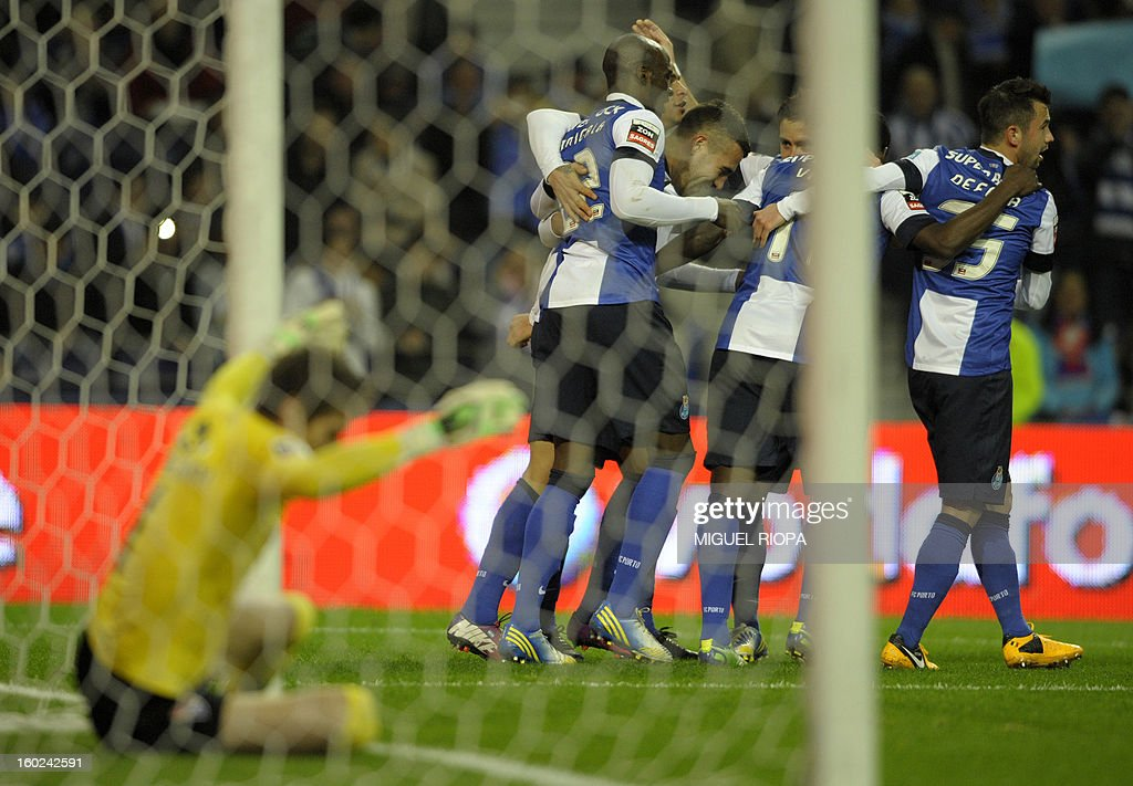 Porto's players celebrate their second score during the Portuguese league football match FC Porto vs Gil Vicente at the Dragao Stadium in Porto on January 28, 2013. AFP PHOTO/ MIGUEL RIOPA