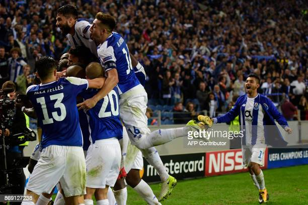Porto's players celebrate their third goal during the UEFA Champions League Group G football match FC Porto vs Leipzig at Dragao stadium in Porto on...
