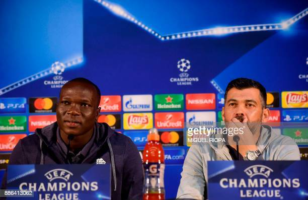 Porto's Portuguese coach Sergio Conceicao and Porto's Cameroonian forward Vincent Aboubakar hold a press conference at the Dragao stadium in Porto on...