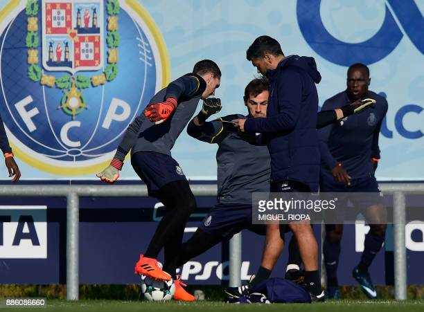 Porto's Portuguese coach Sergio Conceicao walks beside Porto's Spanish goalkeeper Iker Casillas and other teammates during a training session at the...