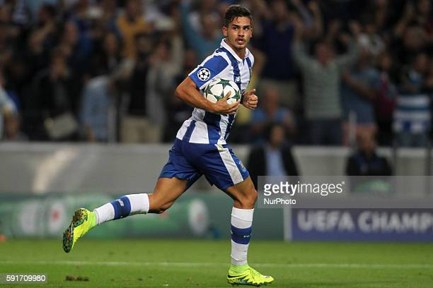 Porto's Portuguese forward Andre Silva celebrates after scoring goal during the UEFA Champions League match between FC Porto and AS Roma at Dragao...