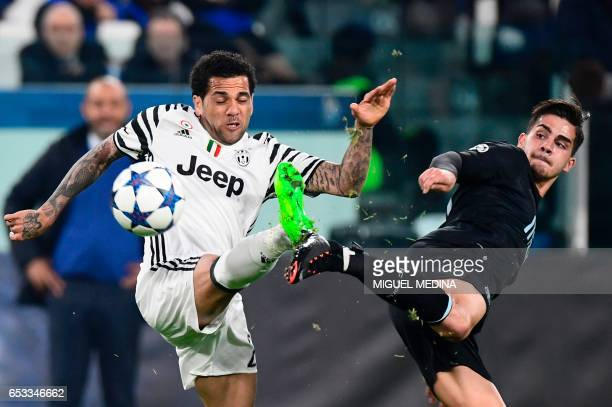 TOPSHOT Porto's Portuguese forward Andre Silva fights for the ball with Juventus Defender from Brazil Dani Alves during the UEFA Champions League...